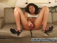 Cute asian hottie toying the brush perishable