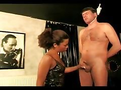 Dominatrix stroking the brush slaves blarney