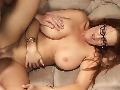 Obese breasted redhead cougar near glasses has a creativity young corporeality